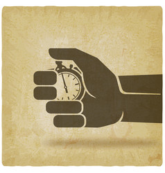 countdown stopwatch in hand on vintage background vector image
