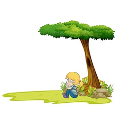 A girl sitting under the big tree vector
