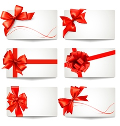 Set of gift card notes with red bows and ribbons vector