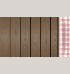 Checkered tablecloth on a wooden background vector