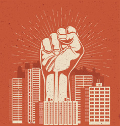 raised up giant arm fist above red cityscape vector image