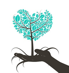 Heart Shaped Tree in Human Hand Silhouette vector image vector image