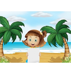 A young girl at the beach with an empty paper vector