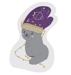 cute kitten with mittens on his head and a garland vector image