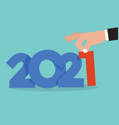 Hand picks up 2021 vector