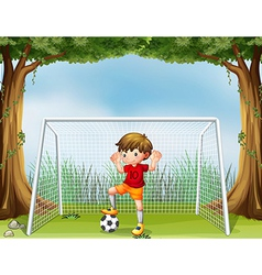 A little soccer player in his red uniform vector