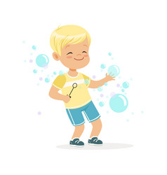 Cute little blonde boy playing bubbles vector