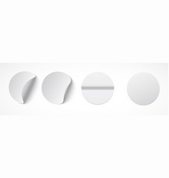 set of round white sticky labels with bent edges vector image