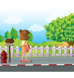 A girl standing near the mailbox at the roadside vector image vector image