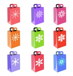 shopping bags with snowflake symbols vector image vector image