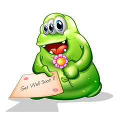 A greenslime monster holding a signage vector image