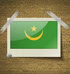 Flags Mauritania at frame on a brick background vector image