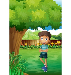 A smiling young man near the tree inside the gated vector image