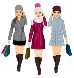 three young fashion women with shopping bags vector image