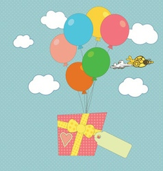A gift carried by balloons vector image