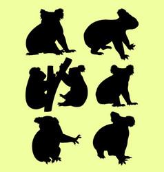 cute koalas gesture animal silhouette vector image