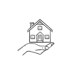hand holding house hand drawn outline doodle icon vector image