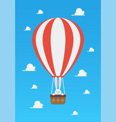 Hot air balloon with rabbit in basket vector