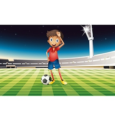 A boy with a soccer ball standing in the soccer vector