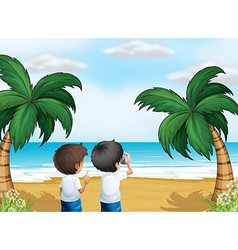 Two photographers at the beach vector image vector image