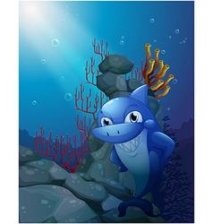 A smiling shark near the rocks vector image