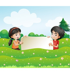 A boy and a girl holding an empty cardboard vector image vector image