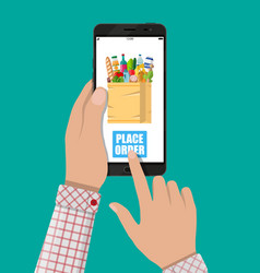 hand and smartphone with shopping bag vector image