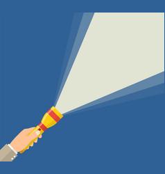 Hand holding flashlight vector