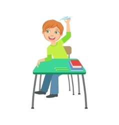 Schoolboy Sitting Behind The Desk In School Class vector image