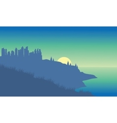 Silhouette of a city in the beach vector
