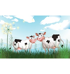 Two cows at the grassland vector image