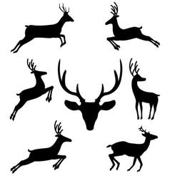 set of black silhouettes of reindeers in vector image
