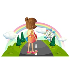A young girl standing in the middle of the street vector