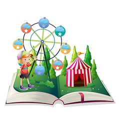 An open storybook with a carnival and a young boy vector image