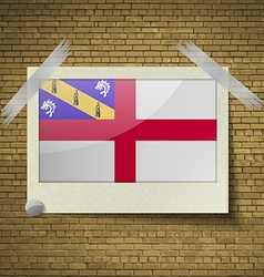 Flags Herm at frame on a brick background vector