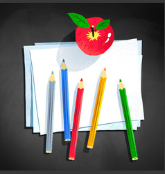 Color pencils and apple laying on paper vector