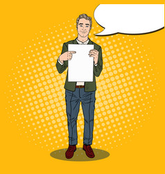 pop art businessman pointing at blank paper sheet vector image
