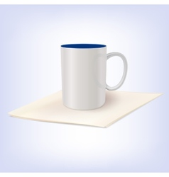 White ceramic cup standing on a napkin vector