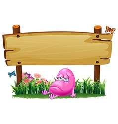 A sad pink monster under the empty signboard vector image vector image
