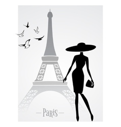 Fashionable lady in front of Eiffel Tower vector image