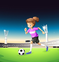 A girl playing football at the field vector image vector image