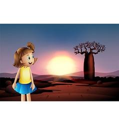 A small girl at the desert wearing blue skirt vector