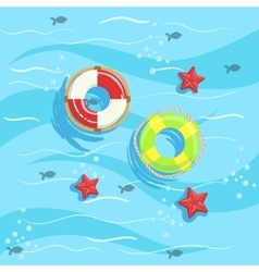 Two Ring Buoys With Blue Sea Water On Background vector image