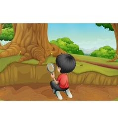 A boy studying the ground in the forest vector image