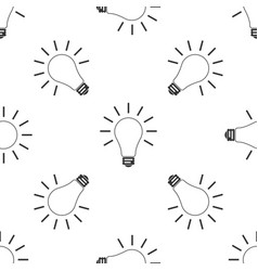 light bulb with rays shine icon seamless pattern vector image