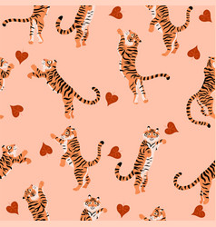 seamless pattern with jumping tigers and autumn vector image