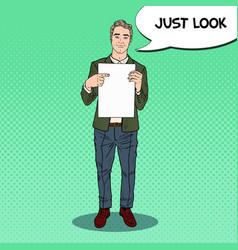Pop art businessman pointing at blank sheet vector