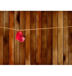 Red heart hanging on old wood EPS8 vector image