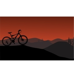 Bike silhouette in hills vector image