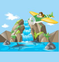 Pilot flying jet over waterfall vector